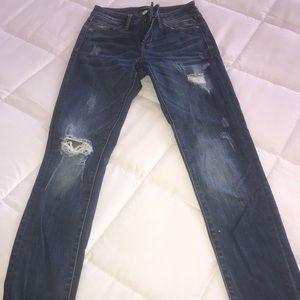 BEBE distressed skinny jeans